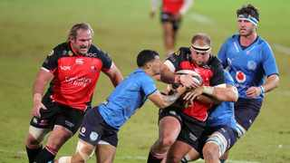 PJ Botha of the Lions challenged by Embrose Papier of the Bulls Samuel Shivambu/BackpagePix