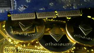 Representations of the Ethereum virtual currency standing on the PC motherboard. File picture: Reuters/Dado Ruvic