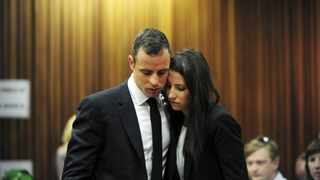 Oscar Pistorius stands beside his sister Aimee during court proceedings on Wednesday, March 19, 2014. Picture: LEON SADIKI