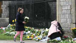 People place with flowers with condolence messages outside Windsor Castle following the passing of Britain's Prince Philip, Duke of Edinburgh, in Windsor, Britain, 09 April 2021. EPA-EFE/ANDY RAIN
