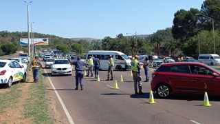 Police stop cars at a roadblock on Eskia Mphahlele Drive in Pretoria. Picture: James Mahlokwane