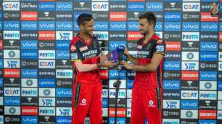 Harshal Patel is presented with the purple cap after guiding Royal Challengers Bangalore to victory over Sunrisers Hyderabad in their Indian Premier League clash on Wednesday. Photo: @RCBTweets/Twitter