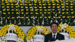 Japanese Prime Minister Shinzo Abe delivers a speech during a ceremony to mark the 75th anniversary of the bombing at the Hiroshima Peace Memorial Park in Hiroshima, western Japan. Picture: Eugene Hoshiko/AP