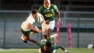 Herschel Jantjies of Springbok Gold side is tackled by Sanele Nohamba of Springbok Green team during the Castle Lager Springbok Showdown at Newlands. Picture: Shaun Roy/Gallo Images via BackpagePix