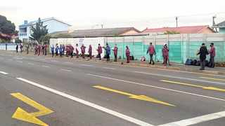 Learners and teachers from Ravensmead Secondary School gathered along Frans Conrade Drive to protest against the Western Cape Education Department's insistence that schools remain open. Picture: Allison Landsberg/African News Agency (ANA).
