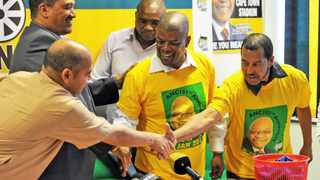 Cape Town-151006-ANC Western cape provincial secretary Faiz Jacobs,Chairperson: Marius Fransman welcoming new members from DA Cyril Mack,Danny Bolton and Grant Mack-Picture by BHEKI RADEBE