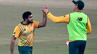 South Africa's Tabraiz Shamsi (left) celebrates after the taking the wicket of Pakistan's Mohammad Rizwan (not pictured) during the third T20 international cricket match at the Gaddafi Cricket Stadium in Lahore on Sunday. Photo: Aamir Qureshi/AFP