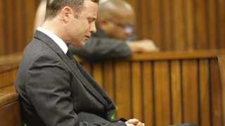 Oscar Pistorius reacts in the dock during the verdict in his murder trial on Thursday. Picture: Kim Ludbrook