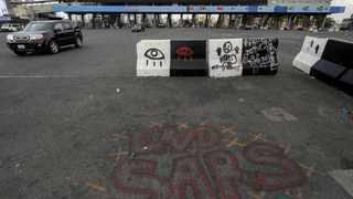 The slogan 'End Sars', referring to the Special Anti-Robbery Squad police unit, are written near the Lekki toll gate, in Lagos. Picture: Afolabi Sotunde/Reuters