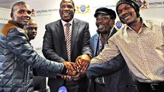 Leaders of COSAS apologize to Hawkers: The leaders of COSAS, Collins Malatji- President (foreground) and Mkhobo Khomongoe- Gauteng Chair (behind) get brought together by MEC Panyaza Lesufi, MEC for Gauteng education (middel) to shake hands as a gesture of forgiveness with Sam Khasibe, Chair for SA informal traders forum (back) and Brian Phaaloh , General secretary of informal traders Forum. COSAS offered a sincere apology to the informal traders forum after there learnes attending a march in JHB CBD engaged in unruly behaviour and robbed informal traders in the CBD during there protest march. Picture: Antoine de Ras, 04/08/2014