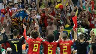 Fans cheer as Belgium players salute them their win over Brazil in their quarter-final against Brazil at the World Cup. Photo: Andre Penner/AP Photo