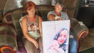 Annie Ash with her sister Bets Fouche and a portrait of her slain daughter Chantell and child Tasneem. Picture: Jacques Naude African News Agency (ANA)