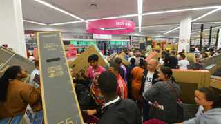 South Africa - Cape Town - 29 November 2019 - Flatscreen televisions were a crowd favourite. Game in Canal walk and their other selected stores across South Africa opened at 24:00 so that customers could take full advantage of the Black Friday deals. Picture Courtney Africa/African News Agency(ANA)