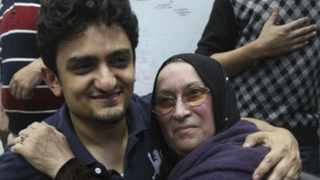 Egyptian Wael Ghonim, a Google marketing manager, who has become a hero of the demonstrators since he went missing, hugs the mother of Khaled Said, a young 28-year-old businessman who died at the hands of undercover police.