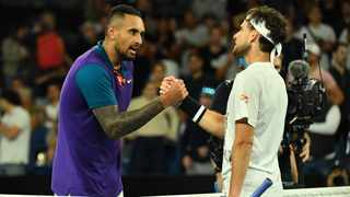 Austria's Dominic Thiem (right) and Australia's Nick Kyrgios shake hands after their men's singles match on day five of the Australian Open tennis tournament in Melbourne on Friday. Photo: Paul Crock/AFP