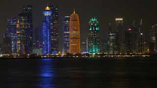 Night scene of the skyline of Doha with towers are seen at Al Dafna Area in Doha