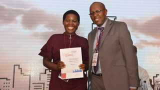 Eskom Development Foundation CEO, Cecil Ramonotsi, congratulates Balisa Ntloko, IkamaYouth fundraising coordinator, on winning the Trialogue Donor's Den 2018 project pitch. Picture: Supplied