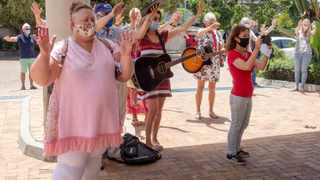 Residents and the worship team of the Plettenberg Bay Methodist Church gathered outside the Plettenberg Bay Mediclinic today to applaud the medical workers for their hard work in fighting Covid-19. Picture: David Ritchie/African News Agency (ANA)