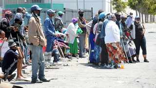 Hundreds of Gugulethu residents queue outside Sassa offices in the area for their grants, some having spent the night to ensure they get helped. Picture :Phando Jikelo/African News Agency (ANA)