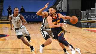 Stephen Curry #30 of the Golden State Warriors dribbles the ball during the game against the San Antonio Spurs. Photo: Supplied