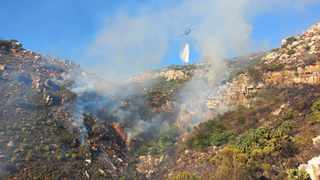 Firefighters are hard at work battling a blaze on the mountain slopes of Simon's Town this morning, two weeks after fighting the massive Cape Town fire. Picture: City of Cape Town