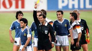 Mexican referee Ernesto Codesal Mendez shows Argentinian legend Diego Maradona a yellow card in the 1990 Fifa World Cup final against West Germany. Picture: AFP