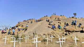 Families and friends of mineworkers killed in the Marikana tragedy gather at a koppie during a cleansing ceremony. Picture: Bongiwe Mchunu/African News Agency (ANA)