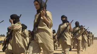 A woman's division of the Polisario Front army marches in the El Ayoun refugee camp, south eastern Algeria. (File photo: AP)