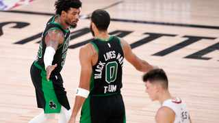 Boston Celtics' Marcus Smart (36) and Jayson Tatum (0) celebrate after a play during the second half the conference final playoff game against the Miami Heat on Friday. Picture: Mark J. Terrill/AP Photo
