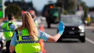 Police man a road block on the outskirts of Auckland as New Zealand's largest city moved to Covid19 Alert Level 3. Picture: Dean Purcell/New Zealand Herald via AP