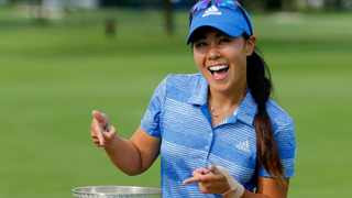 Danielle Kang poses with her trophy after winning the KPMG Women's PGA Championship golf tournament. Photo: AP