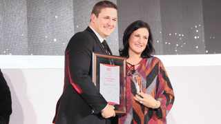 HARDI Swart receives the Financial Planner of the Year Award from Lelane Bezuidenhout, the chief executive of the Financial Planning Institute. Supplied