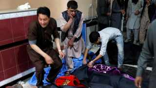 Afghan men look for their relatives at a hospital after a suicide bombing in Kabul. Picture: Mohammad Ismail/Reuters