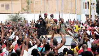 A crowd of people cheer Malian army soldiers at the Independence Square after a mutiny, in Bamako. File picture: Moussa Kalapo/Reuters