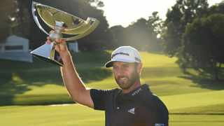 Dustin Johnson poses with the FedExCup trophy winning the Tour Championship. Picture: Adam Hagy/USA TODAY Sports
