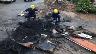 It took about an hour before police were able to secure the crime scene and for forensic investigators to gather evidence. By then the two bodies were burnt beyond recognition. Pictures: African News Agency/ANA