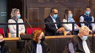 Jean-Claude Lacote (Back 3rd R), 54-years-old, and his Belgian wife Hilde Van Acker (L), 57-years-old, sit in the dock during a session of the Assizes Court of West-Flanders, in Brugge. Picture: Kurt Desplenter / various sources / AFP