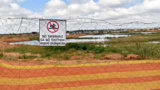 The Newly fenced quarry in Skierlik Mountain View informal settlement. Picture: Thobile Mathonsi African News Agency (ANA)