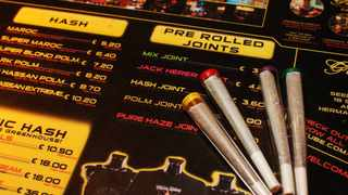 File photo: Pre-rolled joints are seen on an english language menu listing the variety of hash and marijuana on sale at The Green House coffee shop in Amsterdam. Picture: AP
