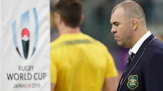 Australia coach Michael Cheika watches as his team warm up before the Rugby World Cup quarterfinal match at Oita Stadium against England. Photo: AP Photo/Aaron Favila