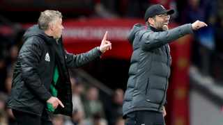 Liverpool's manager Jurgen Klopp and Manchester United counterpart Ole Gunnar Solskjaer gesture during their English Premier League match at Old Trafford in Manchester on Sunday. Photo: Jon Super/AP
