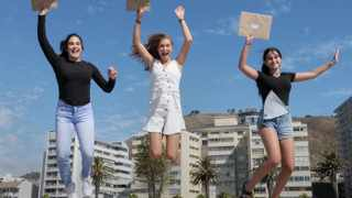 Sarah Katz, Raquel Alexa Kampel and Gia Hasson, matrics from the Class of 2020 at Herzlia High School in Cape Town jump for joy at the release of the IEB exam results on Friday. Photo: Tracey Adams/African News Agency (ANA)