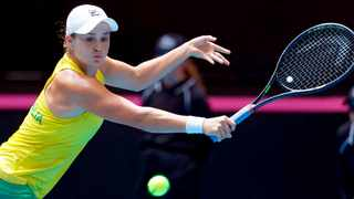 Australia's Ashleigh Barty quit tennis to play cricket in 2014 before returning to the game in 2016. Photo: AP Photo/Trevor Collens