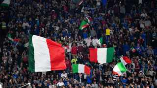 FILE - In this file photo taken on October 12, 2019 Italy's supporters wave Italian National flags during the UEFA Euro 2020 Group J qualifier football match between Italy and Greece. Photo: Alberto Pizzoli/AFP
