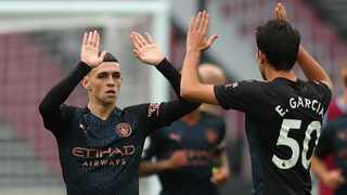 Manchester City's Phil Foden celebrates with Eric Garcia after scoring the equalising goal during their Premier League clash against West Ham United at the London Stadium on Saturday. Photo: Catherine Ivill/Reuters