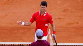 Serbia's Novak Djokovic with Italy's Jannik Sinner after winning their second round match at the Monte Carlo Masters. Photo: Eric Gaillard/Reuters
