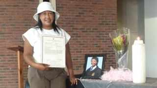 A proud Melony Pedro with her niece's NSC certificate. Picture: Facebook