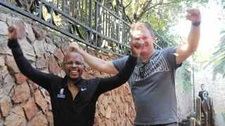 Nelson Mandela Foundation chief executive Sello Hatang and Kevin Ritchie ham it up for the cameras at the bottom of Westcliff Stairs - with Hatang in his jeans. Picture: Tshego Hatang
