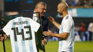 In this 2018 file photo, the President of the Argentina Football Association Claudio Tapia, left, presents a framed team jersey with the number 143 to Argentina's Javier Mascherano prior a friendly soccer match between Argentina and Haiti at the Bombonera stadium in Buenos Aires, Argentina. Photo: Natacha Pisarenko/AP Photo