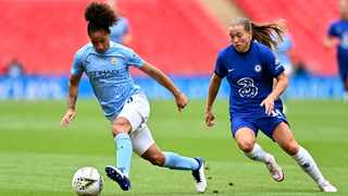 FILE - Manchester City's Demi Stokes, left, runs with the ball away from Chelsea's Fran Kirby. Photo: Justin Tallis/AP
